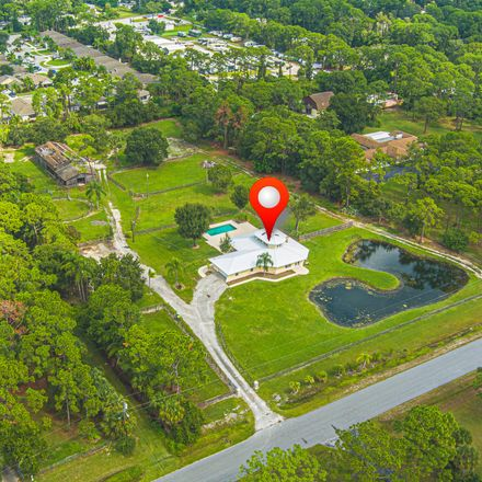 Rent this 4 bed loft on Pinewood Road in Melbourne, FL 32934