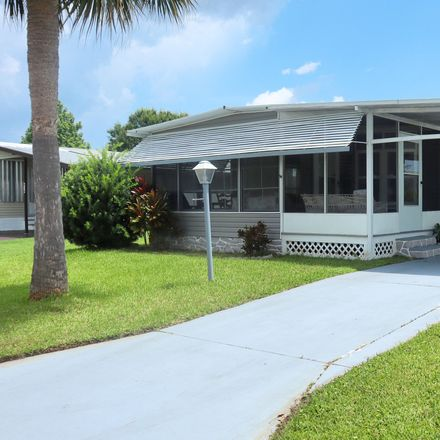 Rent this 2 bed apartment on 812 Silverthorn Court in Barefoot Bay, FL 32976
