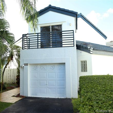 Rent this 4 bed house on 211 Northeast 212th Street in Andover Lakes Estates, FL 33179