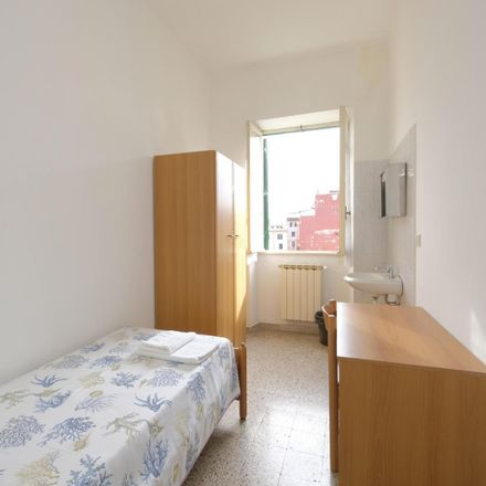 Rent this 8 bed room on Via degli Apuli in 00185 Rome RM, Italy