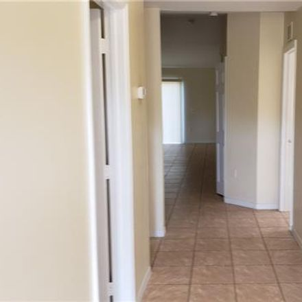 Rent this 3 bed townhouse on 849 Motel Street in Lehigh Acres, FL 33974