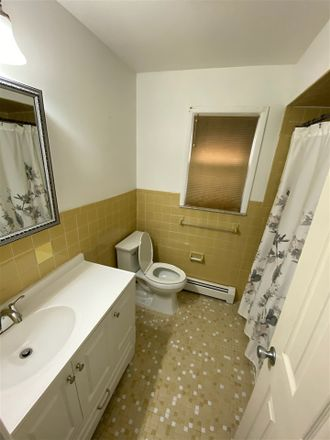 Rent this 3 bed townhouse on 183 West 51st Street in Bayonne, NJ 07002