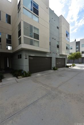 Rent this 3 bed townhouse on Mercier Ln in Huntington Beach, CA