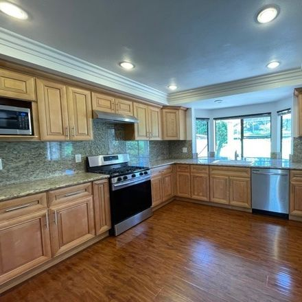 Rent this 4 bed townhouse on Misty Meadows in Irvine, CA