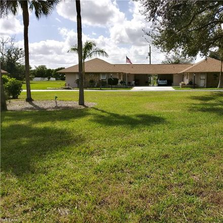 Rent this 2 bed townhouse on 207 Oaklawn Court in Lehigh Acres, FL 33936