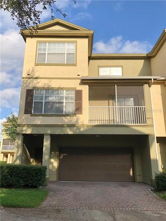 Rent this 3 bed townhouse on 2586 Grand Central Parkway in Orlando, FL 32839