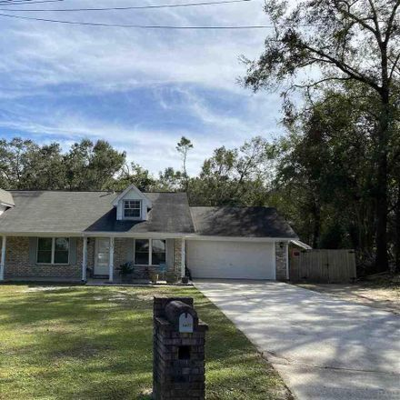 Rent this 4 bed house on 5407 Hollow Oak Ln in Milton, FL
