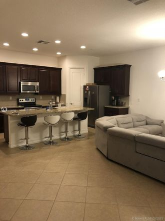 Rent this 3 bed townhouse on 11369 Southwest 13th Street in Pembroke Pines, FL 33025