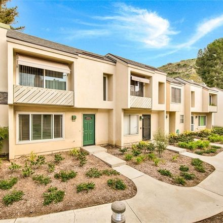 Rent this 3 bed townhouse on 307 North Singingwood Street in Orange, CA 92869