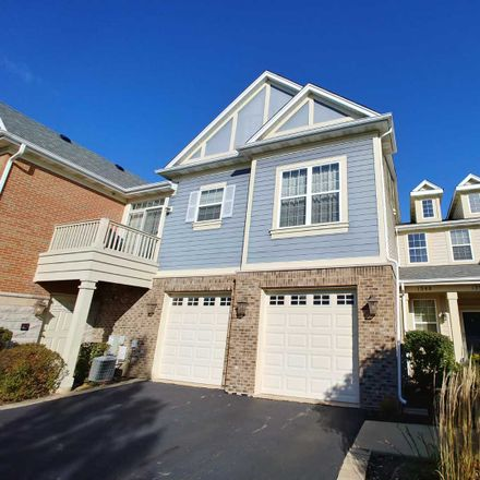 Rent this 4 bed townhouse on Scarboro Rd in Schaumburg, IL