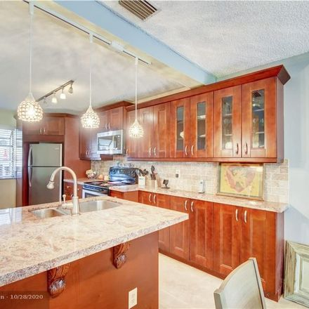 Rent this 3 bed condo on Coconut Creek Pkwy in Pompano Beach, FL