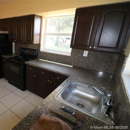 Rent this 2 bed house on 10203 Northwest 12th Avenue in Pinewood, FL 33150