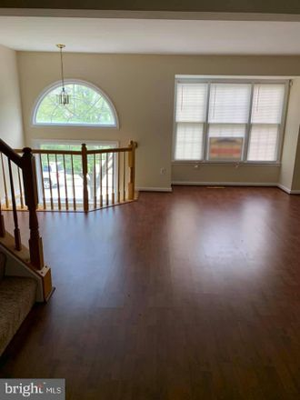 Rent this 3 bed townhouse on 8610 Woodland Manor Drive in Russett, MD 20724