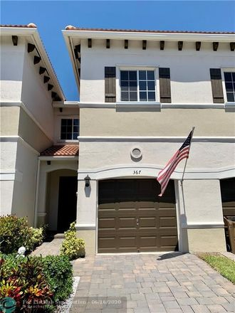 Rent this 3 bed townhouse on Southeast 1st Drive in Deerfield Beach, FL 33441