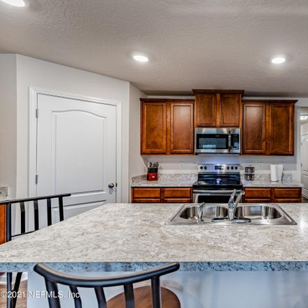 Rent this 4 bed house on White Sturgeon Court in Jacksonville, FL 32226