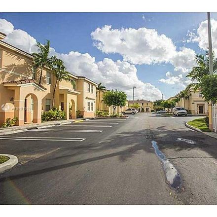 Rent this 4 bed townhouse on W 36th Ave in Hialeah, FL