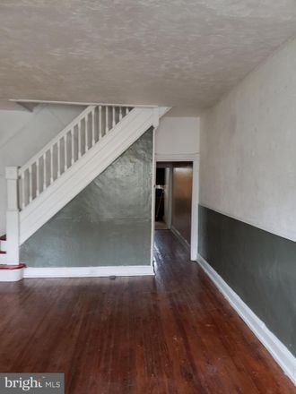 Rent this 3 bed townhouse on 2116 West Baltimore Street in Baltimore, MD 21223
