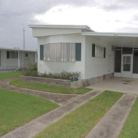 Rent this 2 bed house on Barefoot Circle in Barefoot Bay, FL 32976
