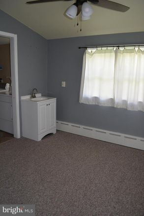 Rent this 2 bed townhouse on 3917 Dexter Street in Philadelphia, PA 19128