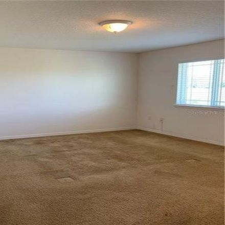 Rent this 3 bed house on 1918 Chatham Place Drive in Meadow Woods, FL 32824