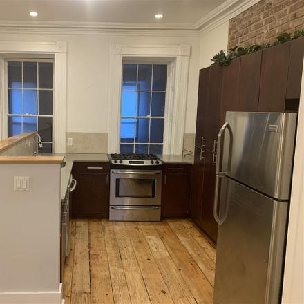 Rent this 2 bed townhouse on Warren St in Jersey City, NJ