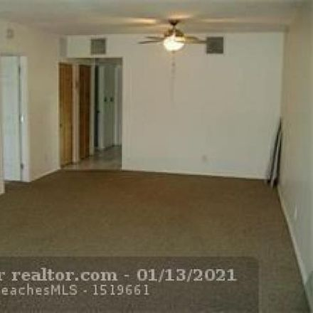 Rent this 2 bed condo on 12 Tangerine Court in Lehigh Acres, FL 33936