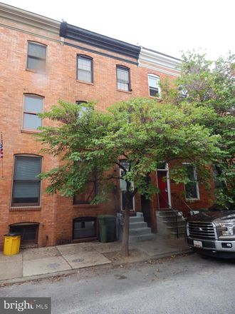 Rent this 4 bed townhouse on 2139 Cambridge Street in Baltimore, MD 21231