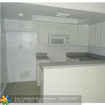 Rent this 3 bed townhouse on 1206 Seaview in North Lauderdale, FL 33068