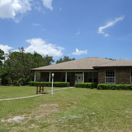 Rent this 4 bed apartment on Palomino Road in Sherman Park, FL 32934