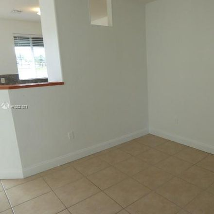 Rent this 3 bed townhouse on 1460 Southeast 24th Court in Homestead, FL 33035
