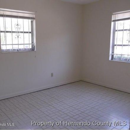 Rent this 4 bed apartment on 10304 Chalmer St in Spring Hill, FL