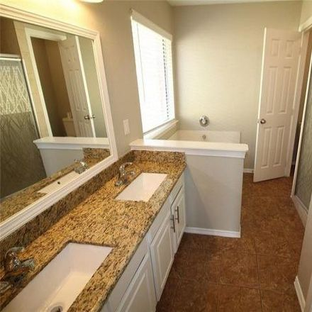 Rent this 4 bed house on 20067 Upland Creek Drive in Harris County, TX 77449