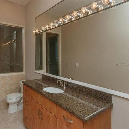 Rent this 4 bed house on 5068 Isleworth Country Club Drive in Summerport Beach, FL 34786