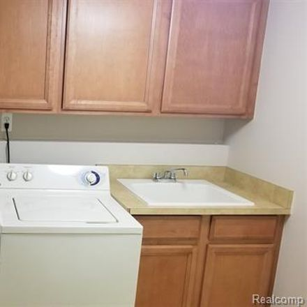 Rent this 4 bed condo on 915 Sandalwood Drive in Troy, MI 48085