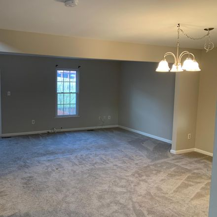 Rent this 3 bed townhouse on 21073 Cornerpost Square in Ashburn, VA 20147