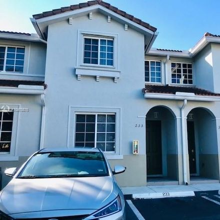 Rent this 3 bed townhouse on Andover in Miami Gardens, FL