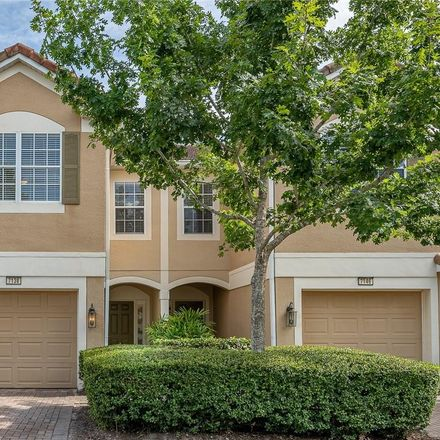 Rent this 3 bed townhouse on 7138 Showcase Ln in Orlando, FL