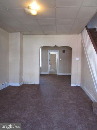 Rent this 3 bed townhouse on 4937 Ormes Street in Philadelphia, PA 19120