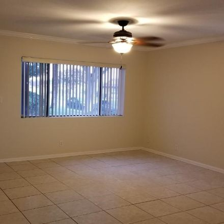 Rent this 3 bed condo on 11729 207th Street in Lakewood, CA 90715