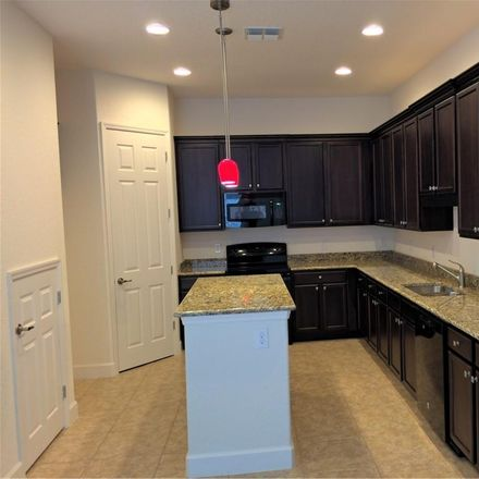 Rent this 3 bed townhouse on 2140 Painter Lane in Kissimmee, FL 34741
