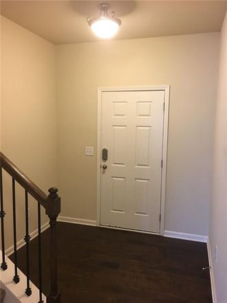 Rent this 3 bed townhouse on Castlebrooke Cir in Cumming, GA