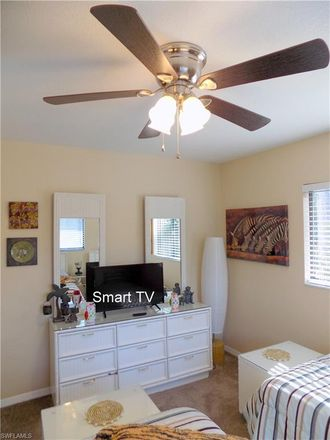 Rent this 2 bed townhouse on 7695 Tamara Lee Court in Lee County, FL 33907