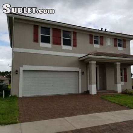 Rent this 4 bed house on 22953 Southwest 115th Avenue in Goulds, FL 33170