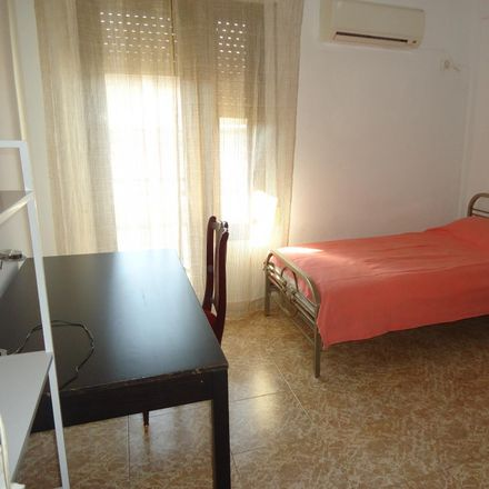 Rent this 5 bed room on Santander Bank in Antonio Maura, 14005 Cordova