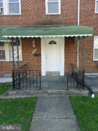 Rent this 3 bed townhouse on 1547 East Cold Spring Lane in Baltimore, MD 21218