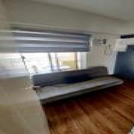 Rent this 2 bed condo on PET Plans Tower in EDSA, Makati