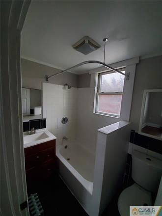 Rent this 4 bed house on Hazel Ave in Perth Amboy, NJ