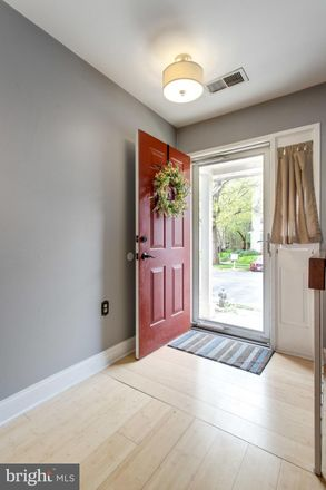 Rent this 2 bed townhouse on 8752 Village Green Ct in Alexandria, VA