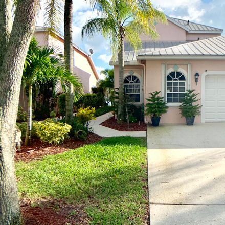 Rent this 3 bed townhouse on 10790 Pelican Drive in Wellington, FL 33414