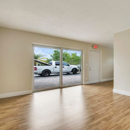 Rent this 2 bed apartment on 593 Palmetto Drive in Lake Park, FL 33403